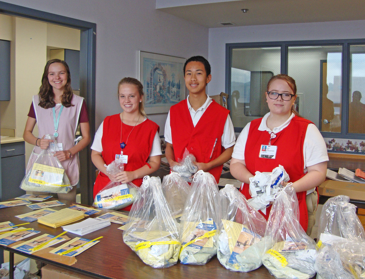 From left, Katie Starnes, Ryann Whitson, Henry Shen and Katie Law assemble falls-prevention packets used for patient care. They are just a few of the 45 Junior Volunteers who have taken time from their summer vacations to serve at Methodist Medical Center.