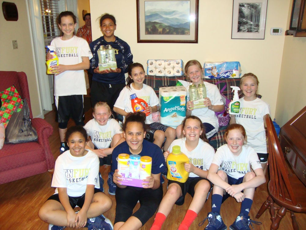 The Gold TN Fury, a fifth grade girls' basketball team, recently visited the Hospitality Houses to deliver items they had collected as part of their team's service project.