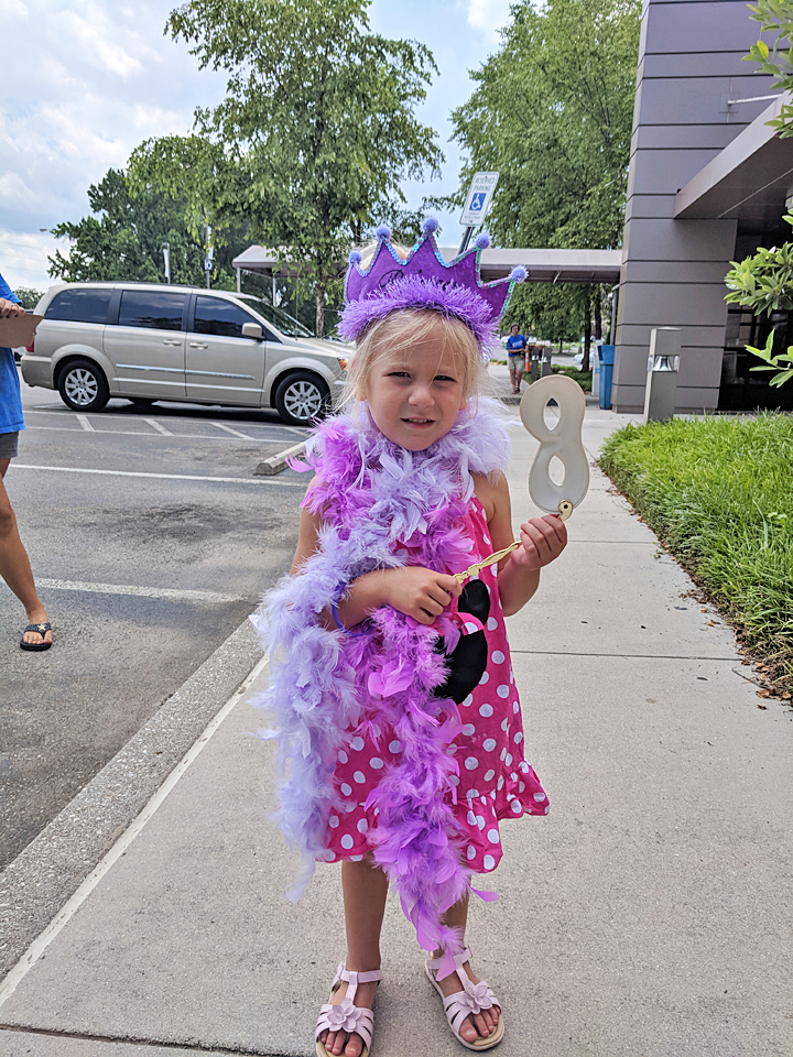 The celebration was a great reason for this young attendee to wear her party best.