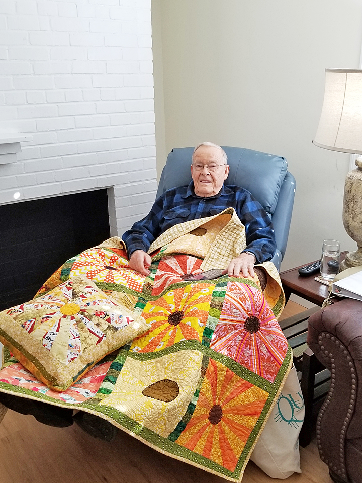 Mr. Bobby Suttles of Crossville, recently received a quilt and a matching pillow from quilting guild member and Hospitality House volunteers, Debbie Robbie.