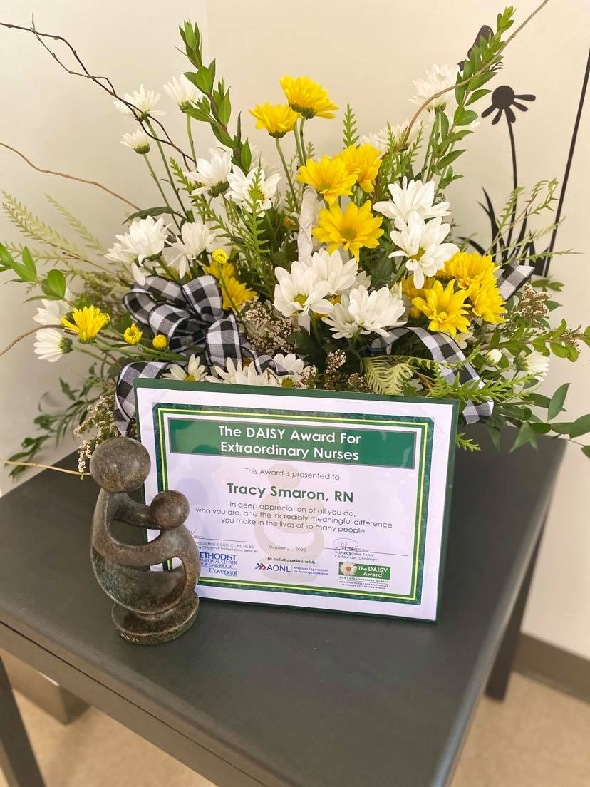 "As a part of Tracy Smaron's DAISY award she received certificate, beautiful arrangement of flowers and a handcrafted sculpture entitled ""The Healer's Touch."""