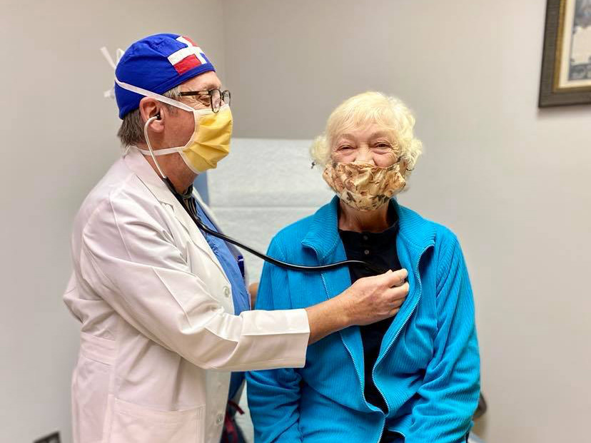 Dr. Hall completes a follow up exam with Methodist's 8,000th open heart patient Mary Lucas